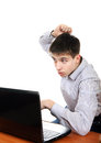 Stressed teenager with laptop isolated on the white background Royalty Free Stock Image