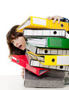 Stressed woman at the office full of folders and work to do isolated on white background Royalty Free Stock Image