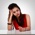 Stressed young asian woman on grey background Stock Image
