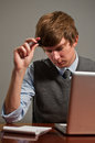 Stressed Young Business Man on Laptop Royalty Free Stock Photo