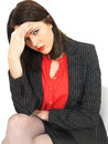 Stressed young business woman a dlsr royalty free image of a looking concerned and worried wearing a red blouse and dark jacket Royalty Free Stock Image