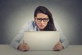 Stressed young woman looking at computer Royalty Free Stock Photo