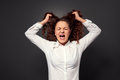 Stressed young woman over grey Royalty Free Stock Photo