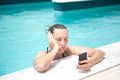 Stressing holidays woman on the phone stressed in pool Royalty Free Stock Image