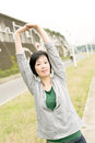 Stretch woman mature of asian her body in outdoor park Stock Photos