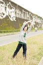Stretch woman mature of asian her body in outdoor park Stock Images