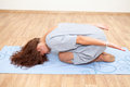 Stretched on floor woman practicing yoga poses an Stock Image