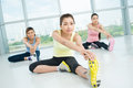 Stretching exercises young women doing in the aerobics class on the foreground Royalty Free Stock Photo