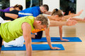 Stretching and gymnastics in fitness club or gym Royalty Free Stock Photography