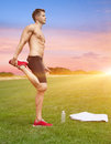 Stretching out in beautiful scenery muscular man Royalty Free Stock Images