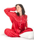 Stretching young woman in red pajamas Stock Image