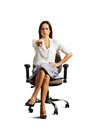Strict businesswoman pointing at camera over white background Royalty Free Stock Images