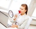 Strict businesswoman shouting in megaphone business concept office Royalty Free Stock Photography