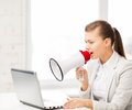 Strict businesswoman shouting in megaphone picture of Royalty Free Stock Image
