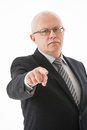 Strict mature businessman indicating you white background Royalty Free Stock Image