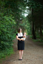 Strict mother holding a baby on the road in the woods Stock Image