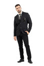 Strict rigid businessman looking at camera with sunglasses in suit pocket full body length portrait isolated over white studio Royalty Free Stock Photos