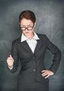 Strict teacher with pointer looking at someone Royalty Free Stock Photo
