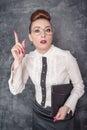 Strict teacher showing finger in eyeglasses with folder Stock Images