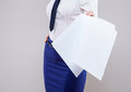 Strict unrecognizable businesswoman holding documents carelessy neutral background Stock Photo