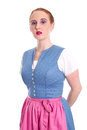 Strict woman isolated in a dirndl on white Stock Images