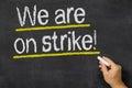 We are on strike written a blackboard Royalty Free Stock Image