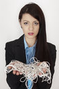 String mess business woman with a great big of in her hands Royalty Free Stock Photography