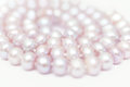 String of pearls delicate pink color in soft focus with highlights Royalty Free Stock Photos