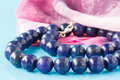 A string of round lapis lazuli beads Royalty Free Stock Photo