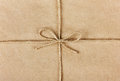 String or twine tied in a bow on kraft paper background Royalty Free Stock Photography