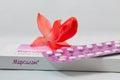 Strip and box of Organon Mercilon contraceptive pills closeup.