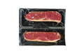 Strip loin steak in plastic wrap isolated Royalty Free Stock Image
