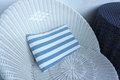 Stripe pillow on wicker chair faded Royalty Free Stock Images