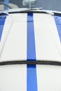 Stripe on sports car white racing hood of a Stock Photos