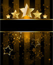 Striped background with stars brown shabby a black banner and five gold Stock Photography