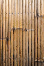 Striped brown bamboo wood wall surface background textured Royalty Free Stock Photos