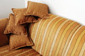 Striped brown sofa and four pillows horizontal Royalty Free Stock Images