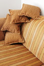 Striped brown sofa and four pillows vertical Stock Image