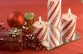 Striped candles and red Christmas decorations Royalty Free Stock Photos