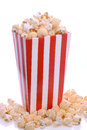 Striped carton of popcorn overflowing red and white fresh with studio background Stock Photos