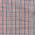 Striped crumpled tablecloth texture of a checkered picnic blanket Royalty Free Stock Photo