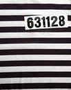 Striped dress for prisoners and number Royalty Free Stock Images