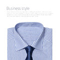 Striped folded shirt with a tie isolated Royalty Free Stock Photos