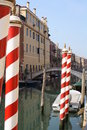 Striped gondola poles (Venice Italy) Stock Photography