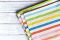 The striped kitchen napkin on wooden table Royalty Free Stock Photography