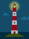 Striped red and white lighthouse at night Royalty Free Stock Photo