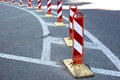 Striped road warning posts and road markings Royalty Free Stock Photo