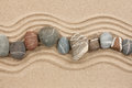 Striped stones on the sand can be used as background Royalty Free Stock Photography