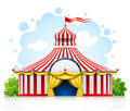 Striped strolling circus marquee tent with flag Royalty Free Stock Photography