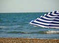 Striped umbrella on the beach and sea Stock Photography